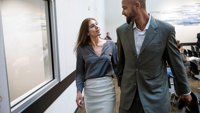 Hope Solo and Jerramy Stevens leave court in August 2014.