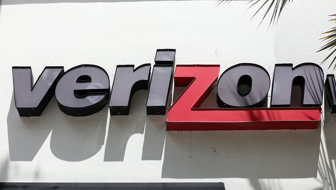 A Verizon sign is seen on the outside of a store in Coral Gables, Florida.