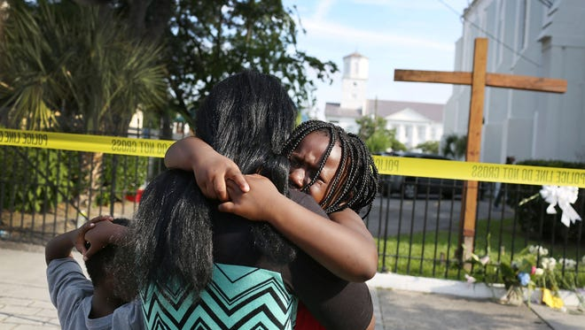 Kearston Farr comforts her daughter, Taliyah, 5, as they stand in front of the Emanuel AME Church last week.