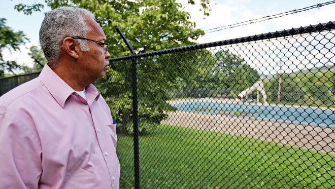 Staunton City Council member Ophie Kier looks down at the Montgomery Hall Park Pool on Monday, June 29, 2015. Kier proposes repairing and reopening the pool for members of the community to swim in once again after it was closed five years ago.