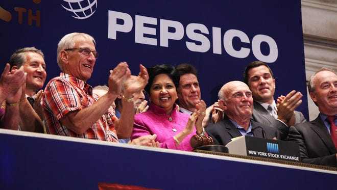 File photo shows Pepsico CEO and Chairwoman Indra Nooyi and other executives at a June 2015 New York Stock Exchange opening bell ceremony.