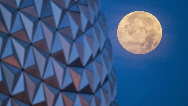 "In this handout photo provided by Disney Parks, the ""supermoon"" is seen with the Epcot center geodesic sphere in the foreground on June 23, 2013, at Walt Disney World Resort in Lake Buena Vista, Fla."