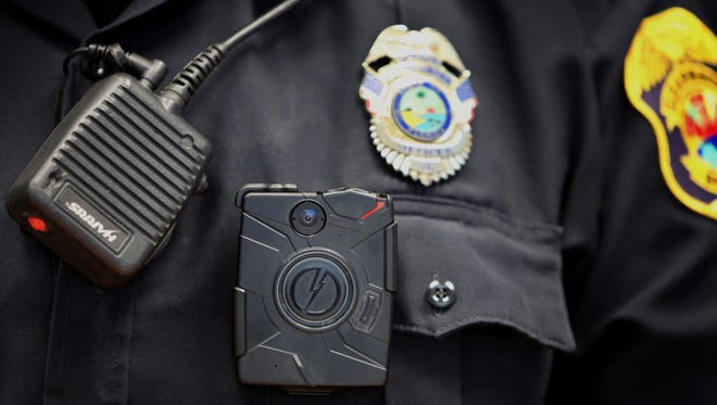 Clearwater Police officer shows a body camera during a training session on in July.