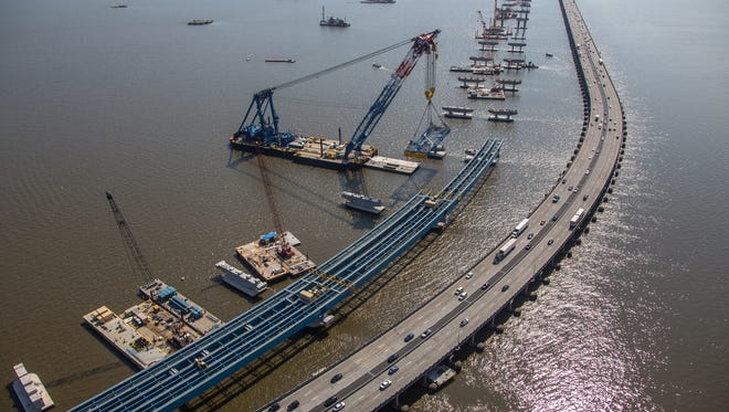 "The Left Coast Lifter, dubbed ""I Lift NY"" for the Tappan Zee Bridge replacement project, moves a girder section into place on the new bridge on July 11."