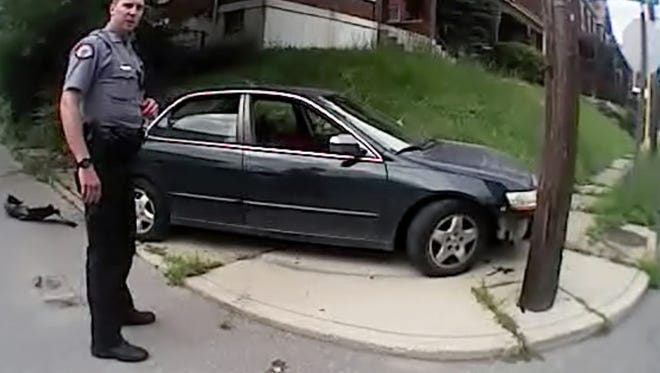 """Ray Tensing tells fellow UCPD officer David Lindenschmidt """"I got tangled in the car, I thought I was gonna get run over."""""""