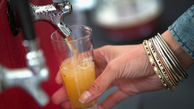Around the Bend Brewery offers a sample of one of their beers at the American Beer Classic craft beer festival at Soldier Field on May 9, 2015 in Chicago, Illinois.