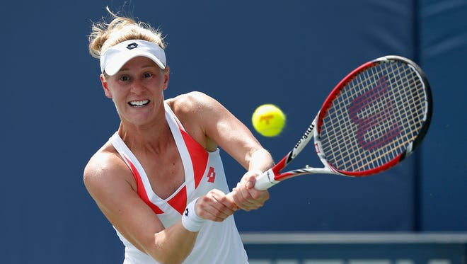 Alison Riske of the United States plays against Carla Suarez Navarro of Spain during day three of the Bank of the West Classic