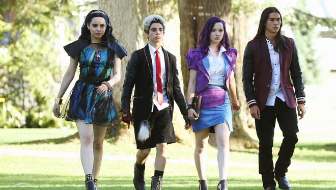 """Sofia Carson, left, Cameron Boyce, Dove Cameron and BooBoo Stewart play teenage sons and daughters of Disney's most infamous villains in Disney's """"Descendants,"""" a new live-action movie."""