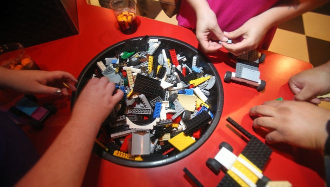 People build cars while attending Adult Fans of Lego Night at Legoland in Yonkers on Aug. 6.