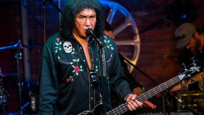"In this Aug. 16, 2015, file photo, Gene Simmons performs during the ""Music On A Mission"" benefit concert held at Lucky Strike Live - Hollywood in Los Angeles. Lt. John Jenal says a warrant was served Thursday, Aug. 20, 2015, at the Simmons home in Benedict Canyon near Beverly Hills, Calif., investigating Internet crimes against children. Jenal says the detectives involved want to emphasize that Simmons and his family were ""extremely cooperative"" and none of them are suspected of a crime. (Photo by Paul A. Hebert/Invision/AP, File)"