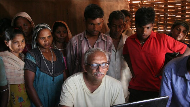 """Ambrish Mehta, a founding member of ARCH-Vahini, helped the Sagai Village map out the land they farm so that they might ultimately be given deed to their land in """"India Awakes."""""""