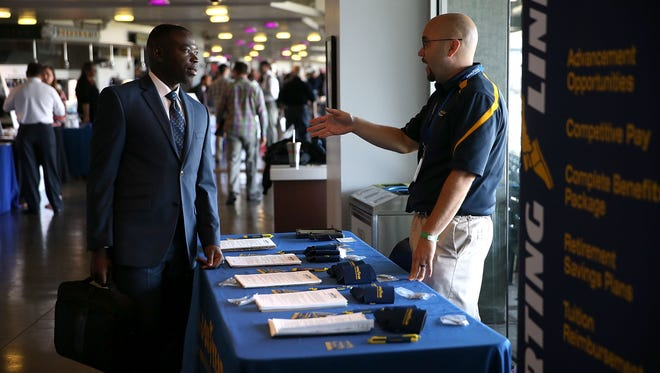 Hiring activity at job fairs like this one has been brisk this year.