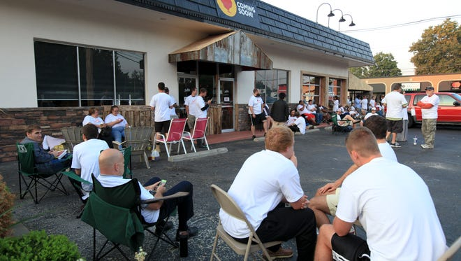 About a hundred waited outside Joella's Hot Chicken on Frankfort Avenue to get vouchers for a year's worth of chicken. The restaurant will opened to the public in September 2015. September 1, 2015