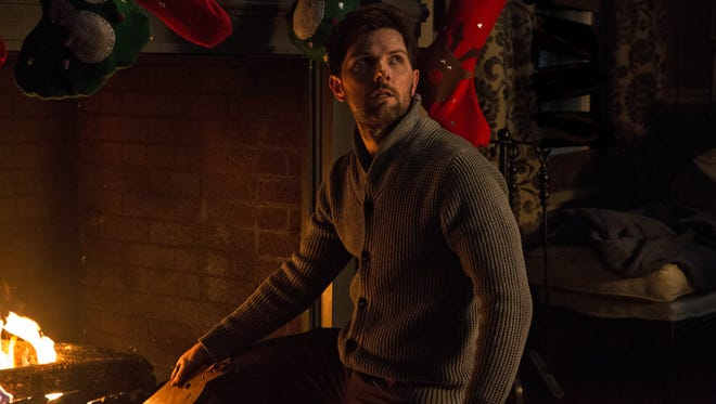Adam Scott plays a dad in a dysfunctional family in the holiday horror comedy 'Krampus.'