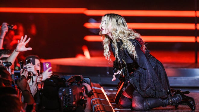 Pop icon Madonna visits Philly to support her 'Rebel Heart' hit record.