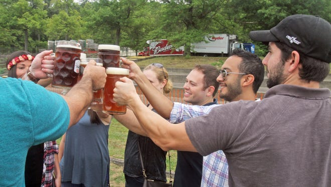 riends raise their beer glasses for a toast as they take in Oktoberfest at the Anthony Wayne Recreation Area in Bear Mountain State Park Sept. 12, 2015. The fall festival, which is being held on weekends through Oct. 28, features a wide selection of beer, traditional Oktoberfest food, and live entertainment.