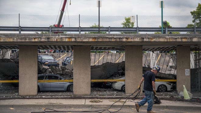 Crews remove cars and debris following the collapsed of a parking garage on July 16, 2015, at UHS Wilson Medical Center in Johnson City.