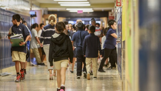 Students walk through Park Avenue Elementary School in Freehold.