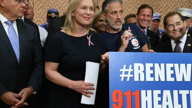 Comedian Jon Stewart , center, speaks at a news conference with, from left, Sen. Robert Menendez (D-NJ), Sen. Kirsten Gillibrand (D-NY), Rep. Carolyn Maloney (D-NY), Sen. Richard Blumenthal (D-CT), Rep. Jerrold Nadler (D-NY) and other members of Congress to demand an extension of the Zadroga 9/11 health bill at the U.S. Capitol on Wednesday in Washington, DC. The former Daily Show host joined ailing police and firefighters in lobbying Congress for a permanent extension of the Zadroga Act's $1.6 billion health and monitoring effort for the 72,000 emergency responders who worked at Ground Zero.  (Photo by Chip Somodevilla/Getty Images) ORG XMIT: 578694767 ORIG FILE ID: 488591150