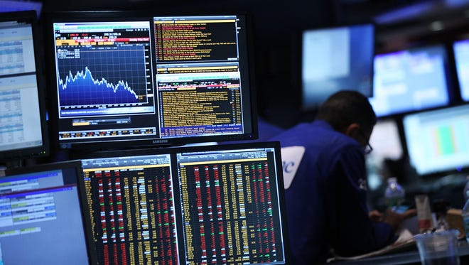Traders work on the floor of the New York Stock Exchange on Sept. 18, 2015.  (Photo by Spencer Platt/Getty Images)