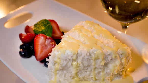 The coconut cake is one of many dessert options at the Spotted Horse Tavern & Dining Parlor, which recently opened in Evangeline Downs Racetrack and Casino.