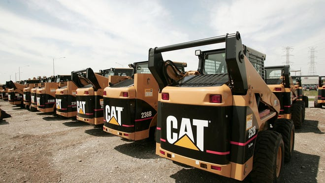 Caterpillar said today it is cutting as many as 5,000 jobs from now until year-end 2016. (Photo by Scott Olson/Getty Images)