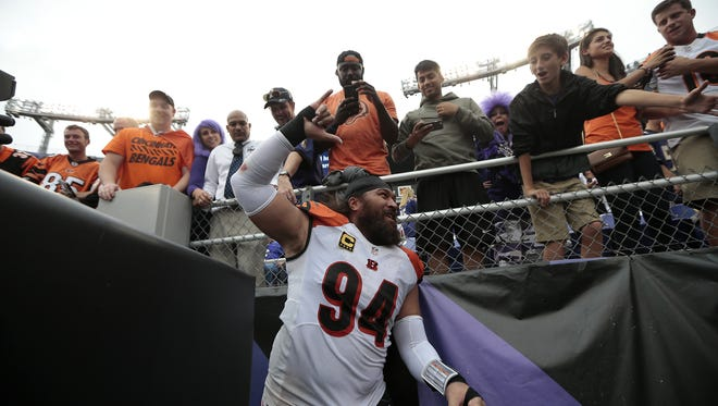Cincinnati Bengals defensive tackle Domata Peko (94) thanks the Bengals fans in attendance as he runs off the field following the fourth quarter of the NFL Week Three game between the Baltimore Ravens and the Cincinnati Bengals at M&T Bank Stadium in Baltimore on Sunday, Sept. 27, 2015. The Bengals advanced to 3-0 with a 28-24 win over the Ravens.