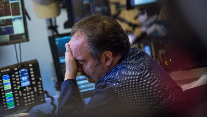 A trader works on the floor of the New York Stock Exchange on September 28, 2015.  (Photo by Andrew Burton/Getty Images)