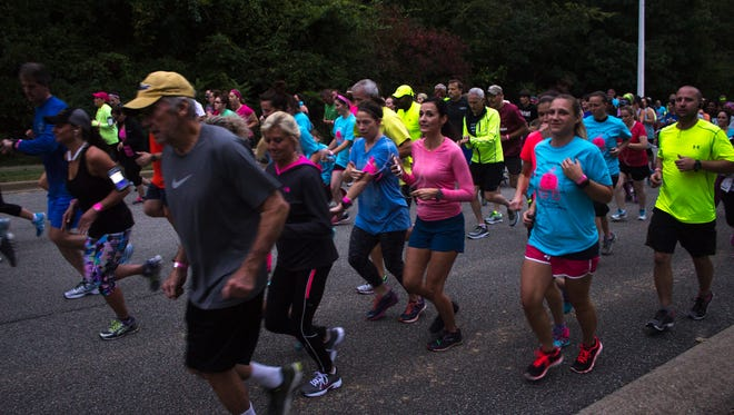 Hundreds of runners participating in the Take Your Girls Night Out 5K Thursday night, raising support and awareness for breast cancer.