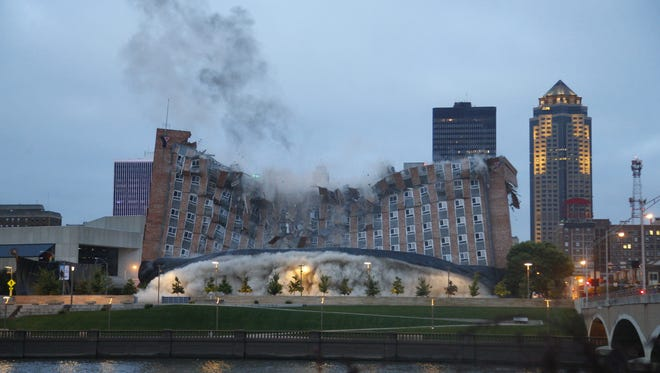 The Riverfront YMCA building is imploded, Des Moines, Iowa, Sunday, Oct. 4, 2015.