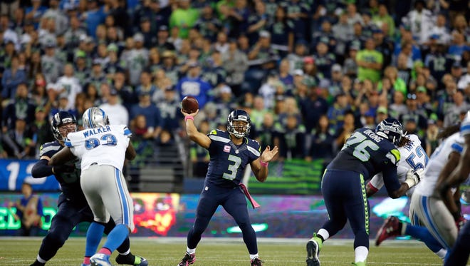 Russell Wilson of the Seahawks passes during the second half against the Lions at CenturyLink Field on Oct. 5, 2015 in Seattle.