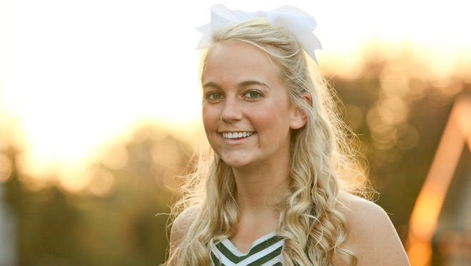 Natalie Metzger, a cheerleader for Trinity High School, in Louisville, KY. Oct. 7, 2105