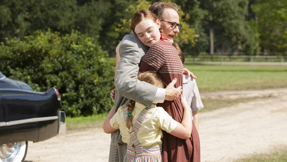 """Elle Fanning and Bryan Cranston in """"Trumbo."""""""
