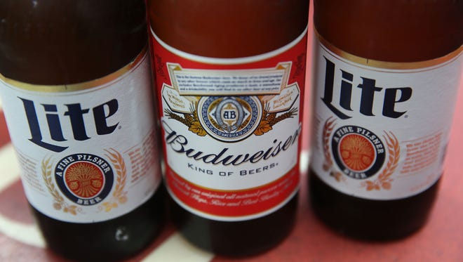 Belgium's Anheuser-Busch InBev, which owns Budweiser and is the world's largest brewer, has agreed to buy No. 2  SABMiller of Britain for $107 billion.