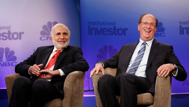 File photo taken in 2015 shows BlackRock Chairman and CEO Laurence Fink (right) with activist investor Carl Icahn (left) at CNBC's Institutional Investor Delivering Alpha conference in New York City.