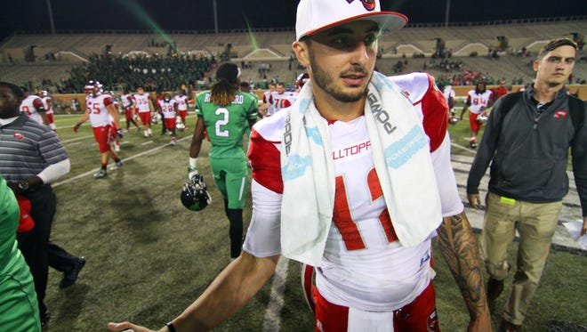 Oct 15, 2015; Denton, TX, USA; Western Kentucky Hilltoppers quarterback Brandon Doughty (12) following a game against the North Texas Mean Green at Apogee Stadium. Western Kentucky won 55-28. Mandatory Credit: Ray Carlin-USA TODAY Sports