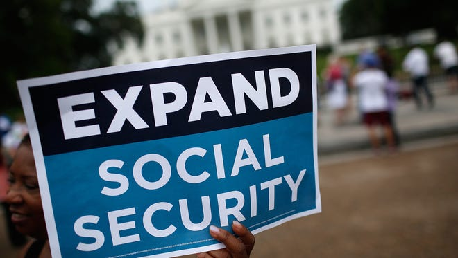 Activists participate July 13, 2015, in a rally urging the expansion of Social Security benefits in front of the White House, Washington, D.C.