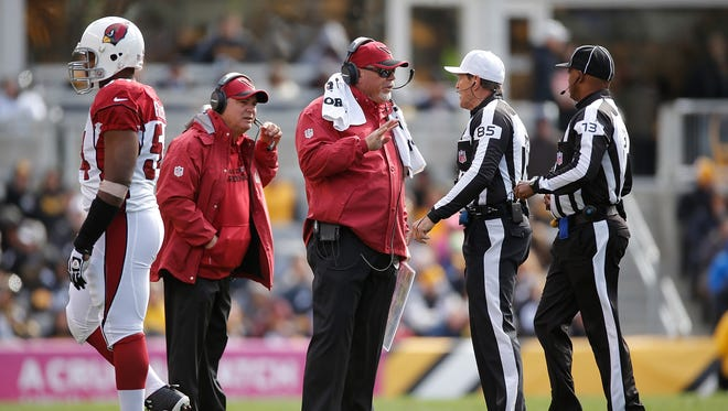 Cardinals coach Bruce Arians has a discussion with the refs during the game against the Steelers.
