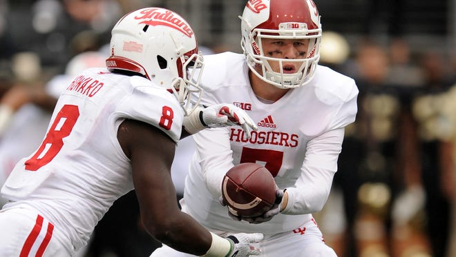 Nate Sudfeld, right, of the Indiana Hoosiers hands off to Jordan Howard against Wake Forest on Sept. 26, 2015, in Winston-Salem, North Carolina.