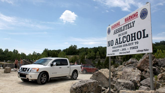 No alcohol signs posted at the Falling Rock Park in La Grange in June 2012.