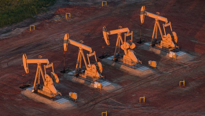 Andrew Burton, Getty Images WATFORD CITY, ND - JULY 30:  Pumpjacks are seen in an aerial view in the early morning hours of July 30, 2013 near Watford City, North Dakota. North Dakota has seen a boom in oil production thanks to new drilling techniques including horizontal drilling and hydraulic fracturing.  (Photo by Andrew Burton/Getty Images) ORG XMIT: 174362712 ORIG FILE ID: 175051434