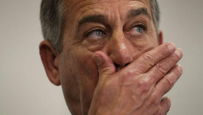 Speaker John Boehner, R-Ohio, listens during a news briefing on Oct. 27, 2015, on Capitol Hill.