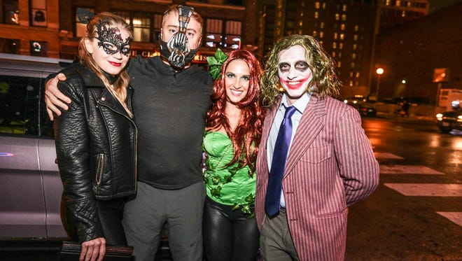 Left to right, Laura Swan, Khris Swan, Kaitlin Abbey, and AllenSwan, attend the Halloween Trolly Bar Crawl in downtown Indy.