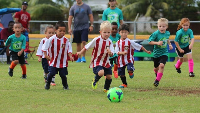 The Strykers and Tsunami play in a Week 8 match in the U6 division of the Triple J Auto Group Robbie Webber Youth Soccer League at the Guam Football Association National Training Center.