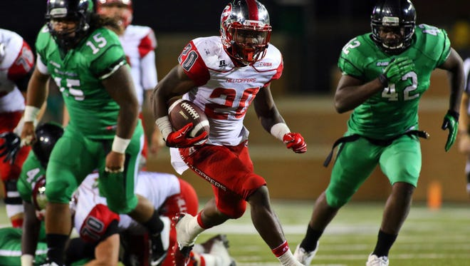 Oct 15, 2015; Denton, TX, USA; Western Kentucky Hilltoppers running back Anthony Wales (20) carries the ball against the North Texas Mean Green during the second half of game at Apogee Stadium. Western Kentucky won 55-28. Mandatory Credit: Ray Carlin-USA TODAY Sports
