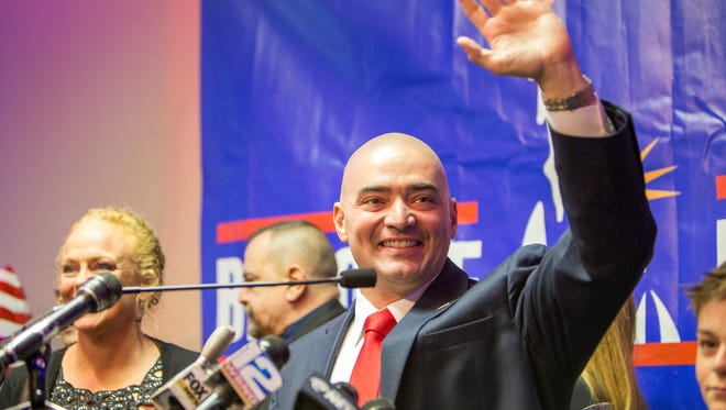 Fred Akshar gives his victory sppech inside after winning the 52nd District State Senate seat on Tuesday.