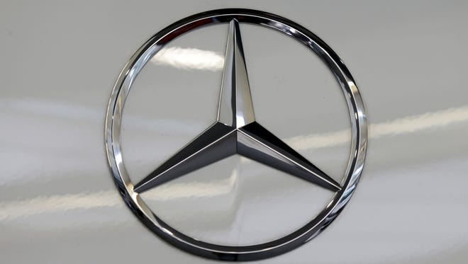 FILE - This Feb. 14, 2013, file photo, shows a Mercedes logo on a Mercedes automobile at the Pittsburgh Auto Show in Pittsburgh.  Mercedes said Wednesday, Nov. 4, 2015, it is recalling more than 126,000 cars and SUVs in the U.S. to fix a problem that can cause the air bags to inflate without a crash. The recall covers the C-300, C-350, and C-63 models from 2008 and 2009, and the GLK-350 4-Matic from 2010. (AP Photo/Gene J. Puskar, File)