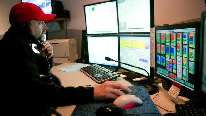Dispatcher Mark Mahoney takes a call at the combined dispatch center in the Wood County Courthouse in Wisconsin Rapids on Nov. 5, 2015.