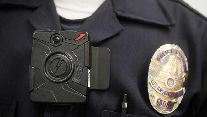 In this Jan. 15, 2014 file photo a Los Angeles Police officer wears an on-body camera during a demonstration in Los Angeles. During the last three months of 2014, Customs and Border Protection tested cameras in simulated environments including the Border Patrol training academy in Artesia, New Mexico. From January to May, it expanded testing to 90 agents and officers who volunteered across the country to use the cameras on the jobs.