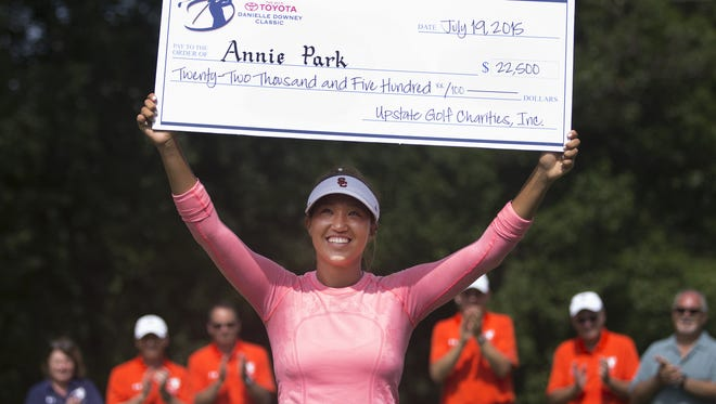 Annie Park holds up the winning check after winning the Symetra Tour's Danielle Downey Classic at Brook-Lea Country Club on July 19.
